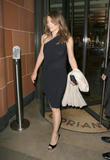 Liz Hurley braless shows pokies through sheer black dress leaving the Cipriani restaurant in Mayfair
